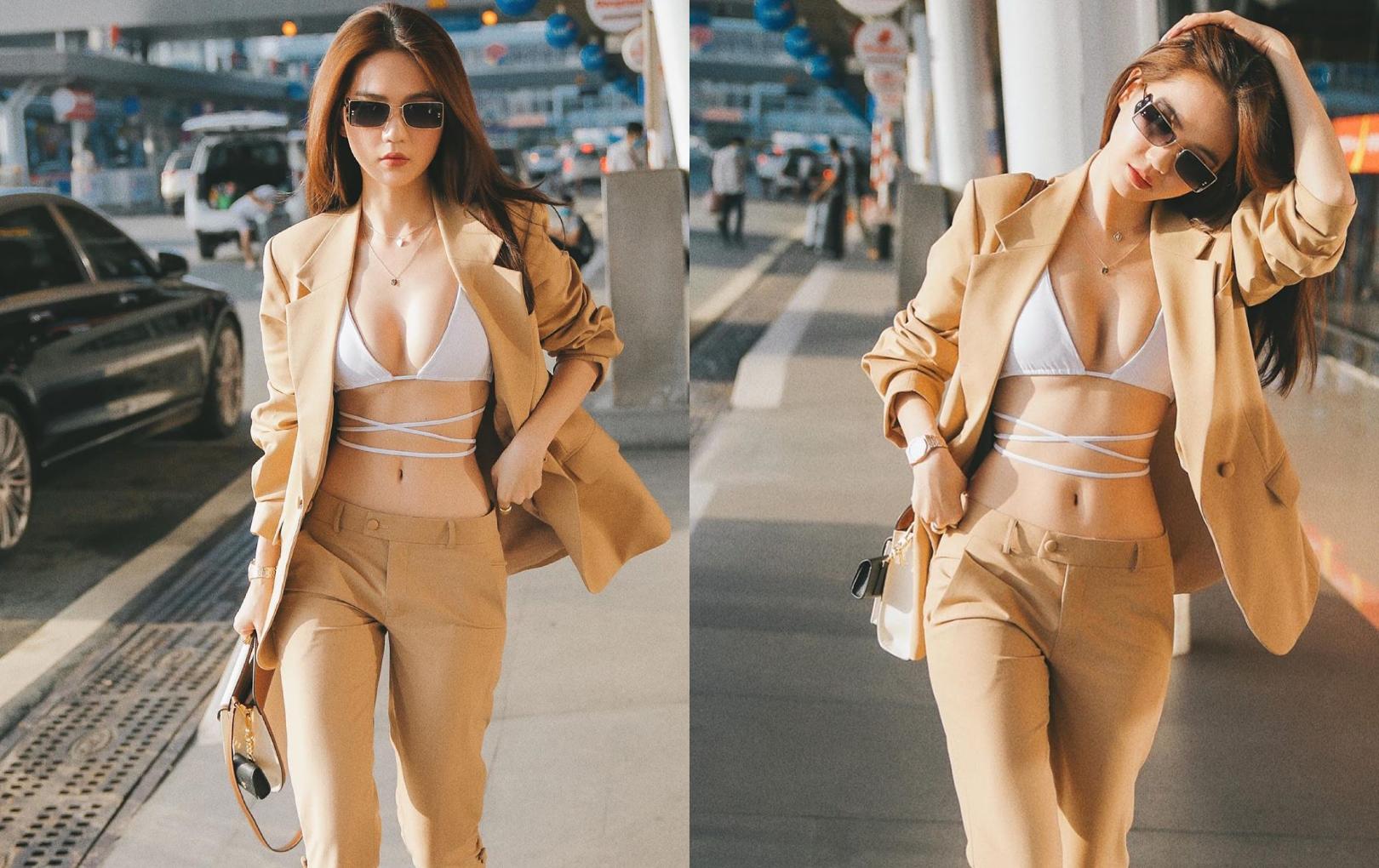 """Ngọc Trinh chơi lớn diện bikini ra sân bay, khoe vòng 1 táo bạo khiến dân tình """"nóng mắt"""""""