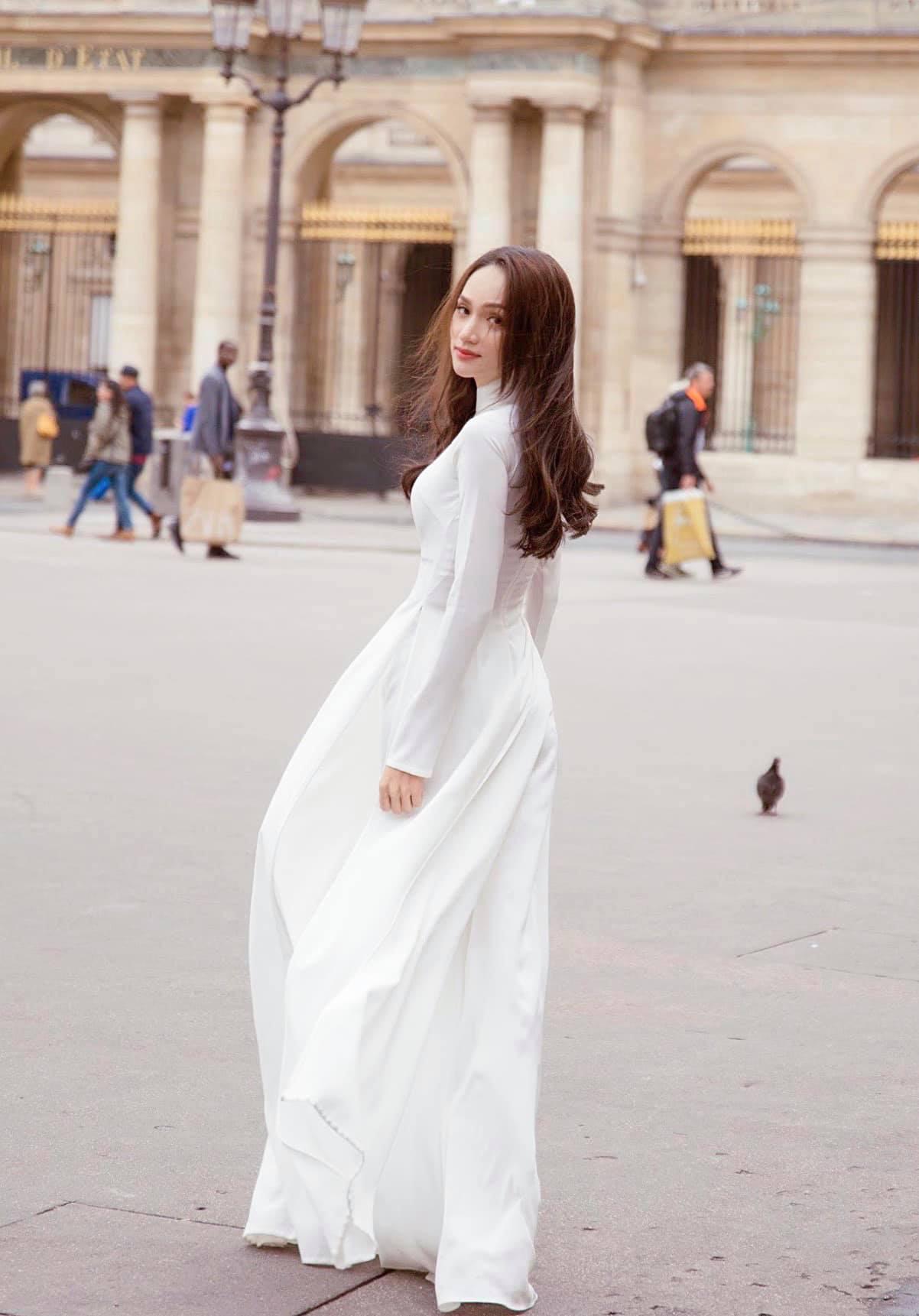 Hương Giang mặc áo dài trắng tinh khôi đẹp tựa nữ thần ở Pháp, thả thính gây bão mạng